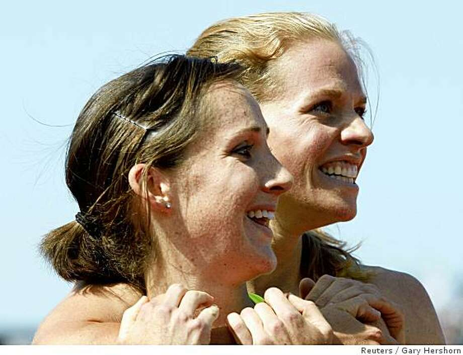Shannon Rowbury (L) celebrates with second place finisher Erin Donohue (R) after winning the women's 1500 meters final at the U.S. Olympic Track and Field Trials in Eugene, Oregon July 6, 2008. Reuters photo by Gary Hershorn Photo: Gary Hershorn, Reuters