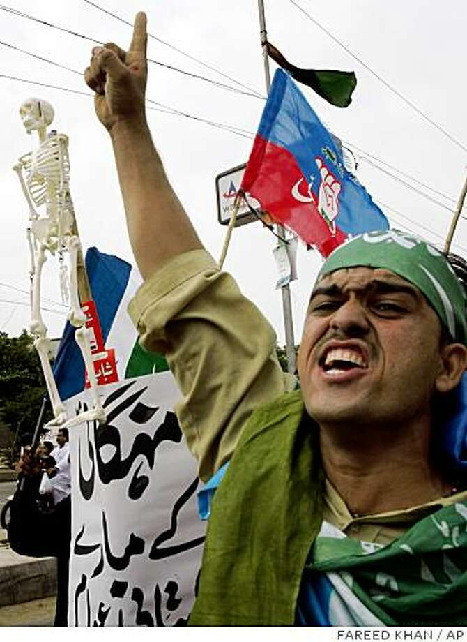 Supporters of Pakistan's religious party, Jamat-i-Islami, or Party of Islam, shout slogans against Pakistan's President Pervez Musharraf as they take part in a demonstration in Karachi, Pakistan, on Sunday, Aug. 17, 2008. President Pervez Musharraf will not resign, his spokesman said Sunday, even after Pakistan's coalition agreed a host of charges with which to impeach the former general. (AP Photo/Fareed Khan) Photo: FAREED KHAN, AP
