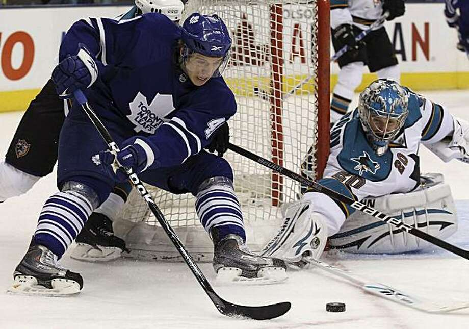 San Jose Sharks goalie Evgeni Nabokov, right, makes a save on Toronto Maple Leafs' Nikolai Kulemin during the second period of an NHL hockey game in Toronto on Monday, Feb. 8, 2010. Photo: Darren Calabrese, AP