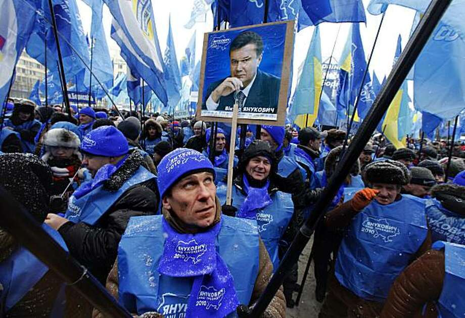 Supporters of Ukrainian opposition leader and presidential candidate Viktor Yanukovych react waving flags of the Party of Regions during a massive rally, in front of Central Election Commission, in Kiev, Ukraine, Monday, Feb. 8, 2010. Thousands gathered in the Ukrainian capital Monday to celebrate the apparent victory of Russian-leaning Viktor Yanukovych in a hostile presidential election campaign. Photo: Alexander Zemlianichenko, AP