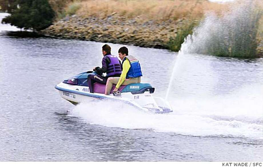 Ran on: 06-20-2004 Two men on a personal water craft cruise the Delta surrounding Bethel Island. PWCs account for an inordinate number of boating accidents in California. Photo: KAT WADE, SFC