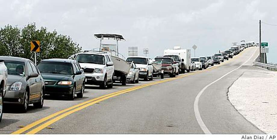 Motorists line up in traffic as they head out of Key West in Fiesta Key, Sunday, Aug. 17, 2008, after officials urged visitors to leave the string of low-lying islands ahead of Tropical Storm Fay, which forecasters said could strengthen to a hurricane. (AP Photo/Alan Diaz) Photo: Alan Diaz, AP