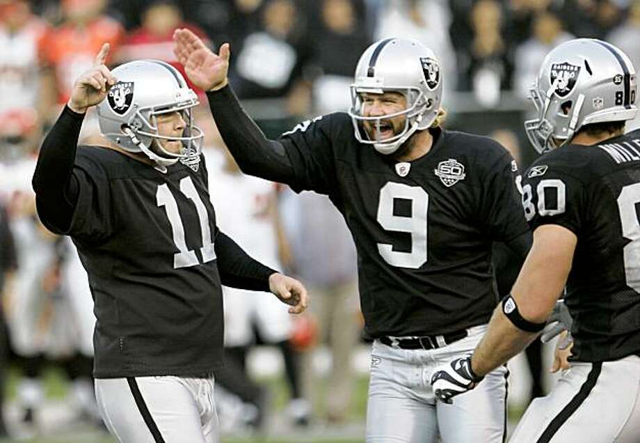 Oakland Raiders PK Sebastian Janikowski (11) is congratulated by punter Shane Lechler (9) after Janikowski scored the winning field goal against the Cincinnati Bengals late in the fourth quarter in an NFL football game, in Oakland, Calif., Sunday, Nov. 22, 2009. The Oakland Raiders upset the Cincinnati Bengals 20-17. (AP Photo/Paul Sakuma) Photo: Paul Sakuma, AP
