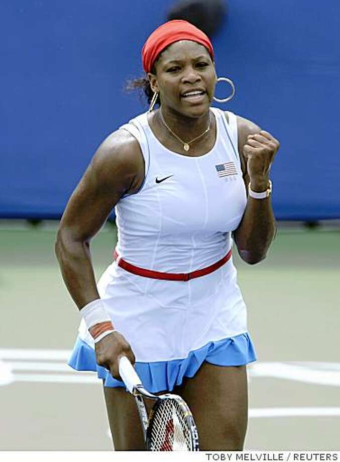 Serena Williams of the U.S. celebrates after defeating Samantha Stosur of Australia in a women's singles second round tennis match at the Beijing 2008 Olympic Games August 12, 2008.     REUTERS/Toby Melville (CHINA) Photo: TOBY MELVILLE, REUTERS