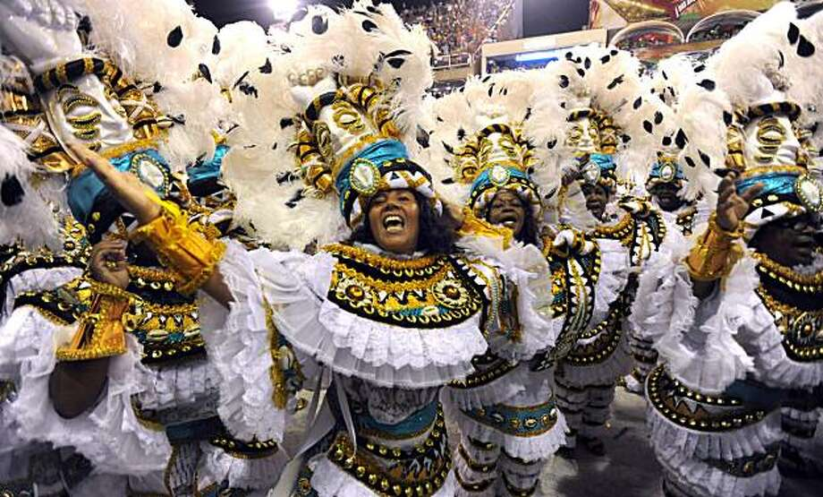 Revellers of the Villa Isabel samba school perform at the Sambodrome during the second night of Rio de Janeiro's famed Carnival on February 16, 2010. A child samba queen who broke down in tears as she fitfully paraded in the harsh glare of the media, andtwo killings during festivities, marred the climax of Rio's famed Carnival on February 15. Photo: Juan Barreto, AFP/Getty Images