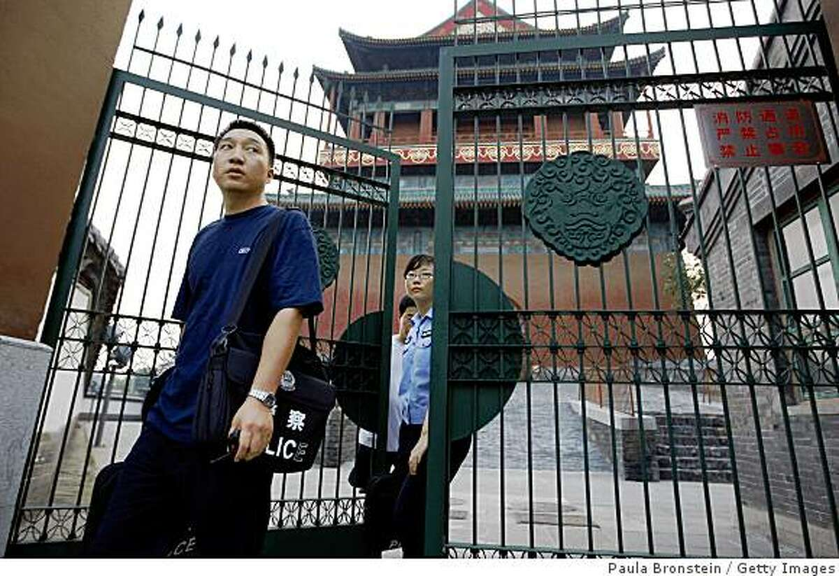 BEIJING, CHINA - AUGUST 9: A Chinese policeman walks out from the historic Drum Tower where an American tourist was killed and another seriously injured August 9, 2008 in Beijing, China.The American, a relative of a US Olympic Volleyball coach, is believed to have been killed by 47-year-old Tang Yongming in a stabbing attack who later took his own life by jumping off the Drum Tower. This incident raises fears about the security on the first day of the Olympic Games. (Photo Paula Bronstein/Getty Images)