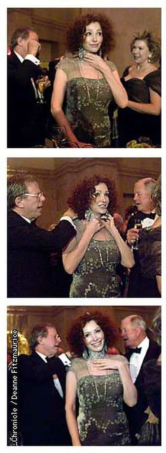 Ann Getty accented her Badgley Mischka pewter sheath with a  turn-of-the-century choker from London that proved challenging when  the clasp came loose. Sandy Walker and Jack Owsley came to her aid  during cocktails. Chronicle Photos by Deanne Fitzmaurice