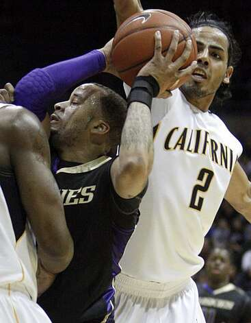 Washington's Venoy Overton, left, maintains possession as California's Jorge Gutierrez, right, tries to strip the ball during the first half of an NCAA college basketball game Thursday, Feb. 11, 2010, in Berkeley, Calif. Photo: Ben Margot, AP