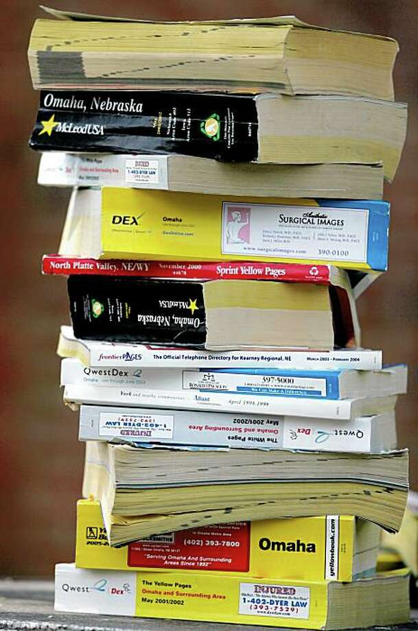 A stack of phone books -- yellow pages and white pages Photo: Nati Harnik 2008, AP