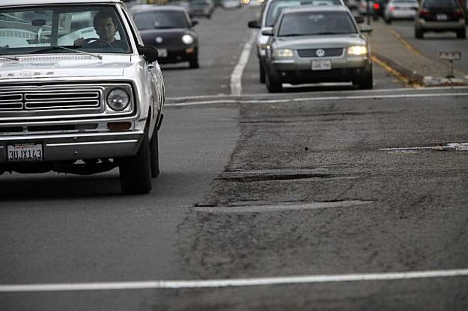Cars headed over a pot holes and cracked road at Route 185 (Mission Blvd) on Wednesday, Dec. 16, 2009 between San Leandro and Hayward, Calif. The Bay Area's roads are the worst in the country topped only by roads in Los Angeles. Photo: Mike Kepka, The Chronicle