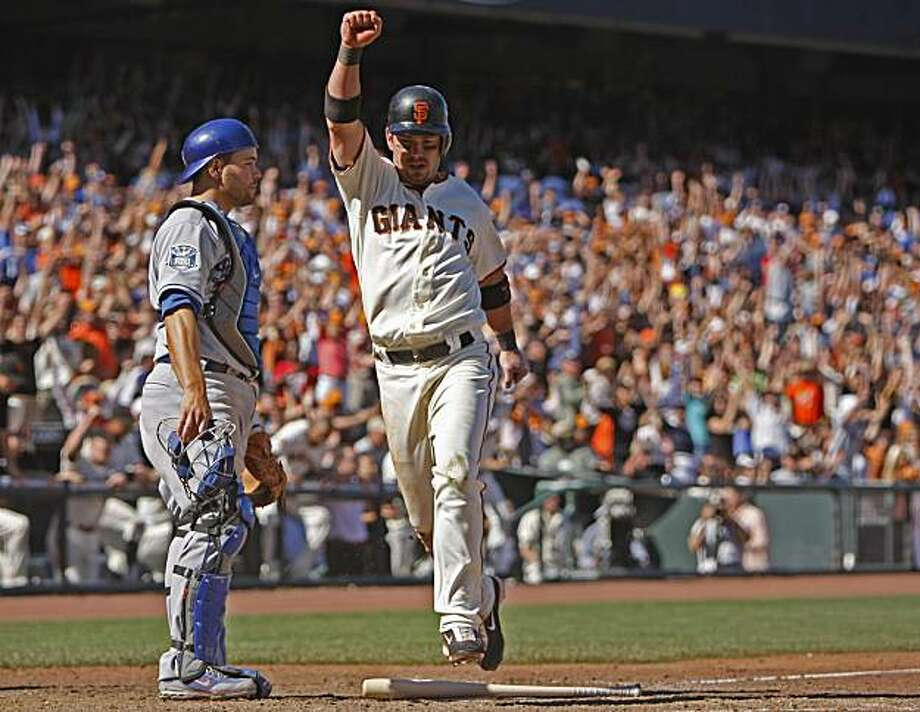 San Francisco Giants' Aaron Rowand crosses homeplate on Eugenio Velez single up the middle defeating the Los Angeles Dodgers, Sunday Aug. 10,  2008, 4to 3, in San Francisco, Calif. Photo: Lacy Atkins, The Chronicle