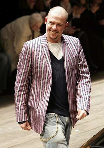 FILE - In this March 3, 2006 file photo, British fashion designer Alexander McQueen aknowledges applause after the presentation of his ready-to-wear fall/winter 2006-2007 fashion collection, in Paris. McQueen was found dead at his London home on Thursday,Feb. 11, 2010, his spokeswoman said. He was 40 years old. Photo: Michel Euler, AP