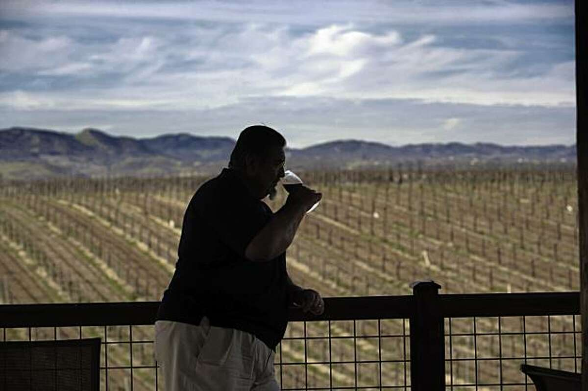 The Paso Robles wine country. Gary Eberle tastes wine on the deck overlooking the vineyards at Eberle Vineyards' tasting room.
