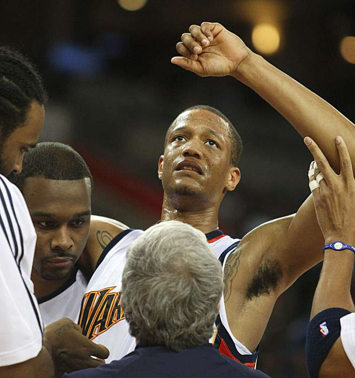 Golden State Warriors' Anthony Randolph is assisted off the court after injuring his ankle during the first half of an NBA basketball game against the Sacramento Kings, Friday, Jan. 8, 2010, in Oakland, Calif.
