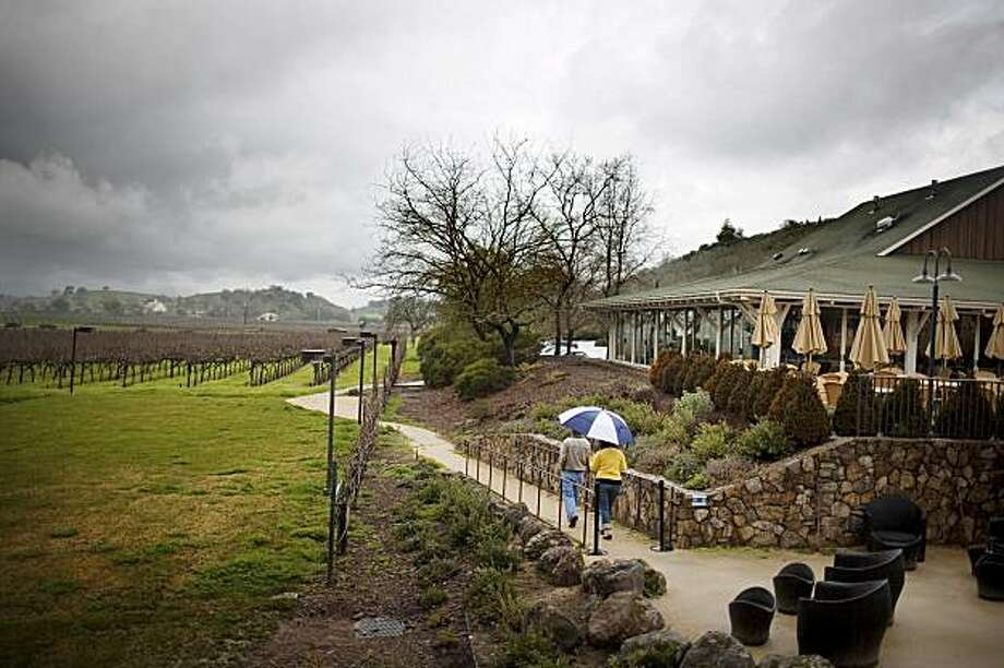 A couple walks along the path at Mumm Napa, Rutherford, Ca., on Saturday, Feb. 6, 2010. Photo: Lianne Milton, Special To The Chronicle