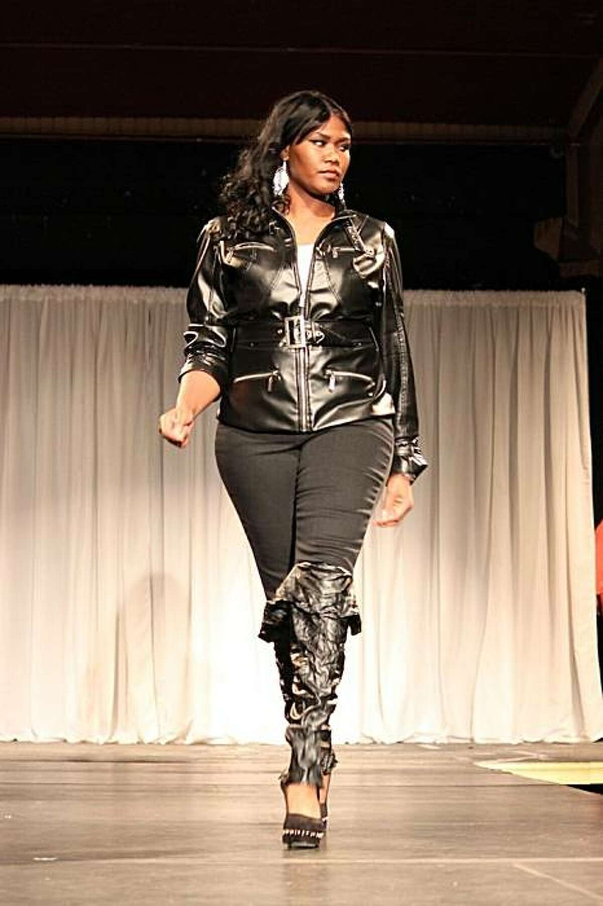 A model shows a look from Ashley Stewart.
