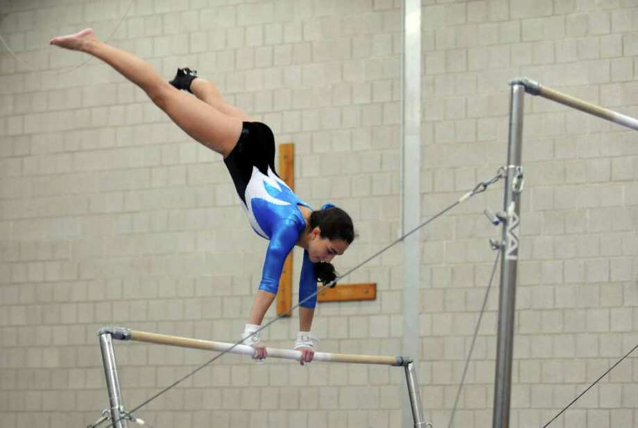 Staples' Emily Fishman competes on uneven bars during their gymnastics meet with Darien at Weston Middle School Tuesday, Feb. 7, 2012. Photo: Autumn Driscoll / Connecticut Post