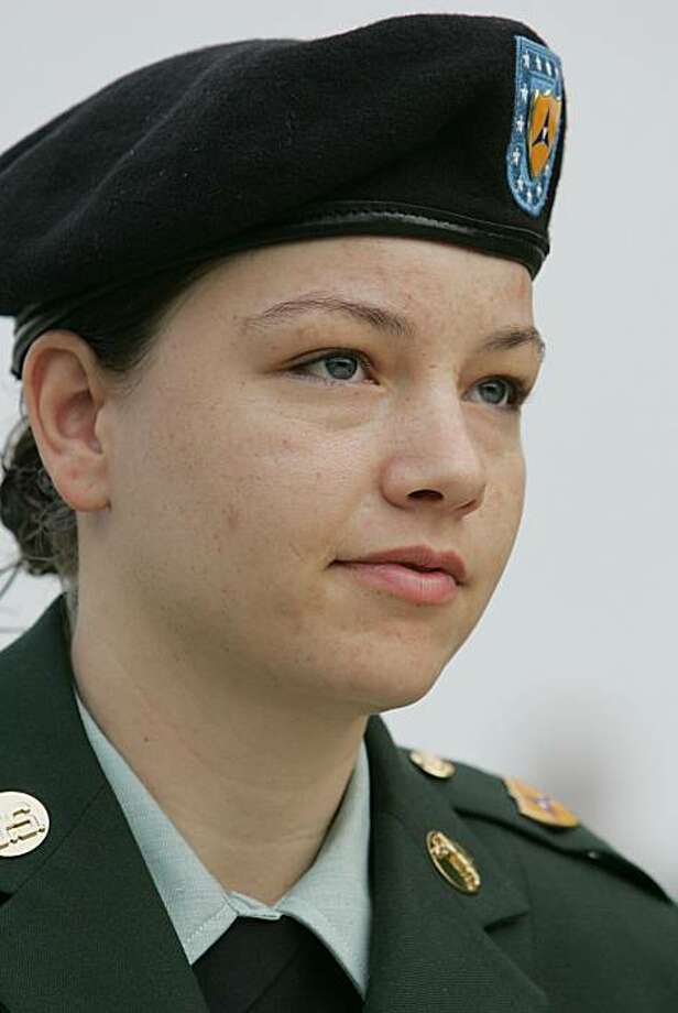 Spc. Sabrina D. Harman arrives at the courthouse for the first day of her trial in Fort Hood, Texas, Thursday, May 12, 2005. Photo: David J. Phillip, AP