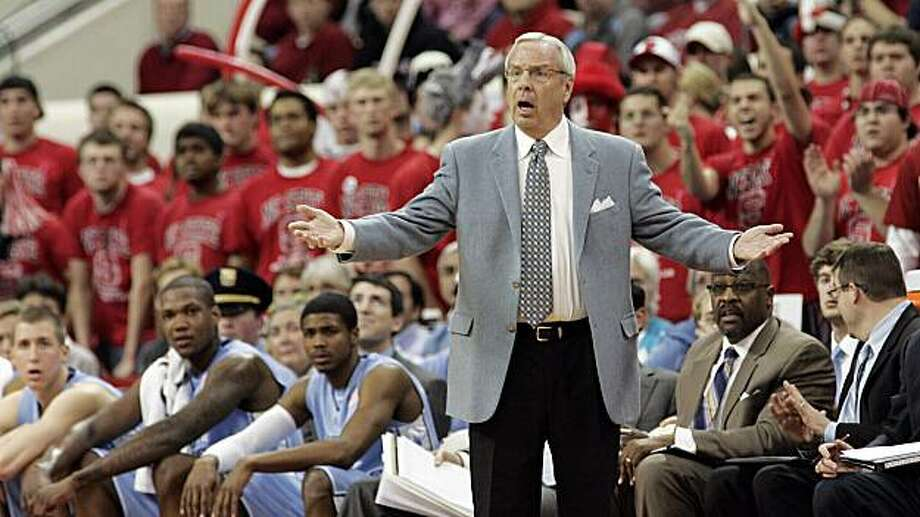FILE- In this Jan. 26, 2010, file photo, North Carolina head coach Roy Williams instructs his team during the second half against North Carolina State during a NCAA college basketball game in Raleigh, N.C. The losses are piling up so fast that the Tar Heels would have to pull off a big turnaround just to reach the NCAA tournament. And now, of all times, highly ranked rival Duke is next up on the schedule. Photo: Jim R. Bounds, AP