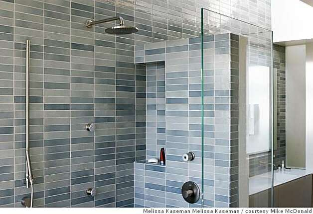 The masterbathroom has a soaking tub as well as a shower. This bathroom and the three others in the house are all tiled with Heath ceramic tiles. The faucets in all the bathrooms are equipped to provide on-demand hotwater so no water has to run into the drain while waiting for hot water. Photo: Melissa Kaseman Melissa Kaseman, Courtesy Mike McDonald