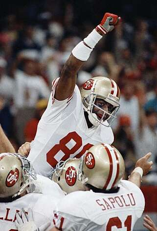 FILE - In this Jan. 28, 1990 file photo, San Francisco 49ers wide receiver Jerry Rice raises his fist in jubilation after scoring his second touchdown of the day with 34 seconds left in the second quarter against the Denver Broncos in New Orleans at SuperBowl XXIV. Rice caught more passes and scored more touchdowns than anyone else. Emmitt Smith ran for more yards than any other NFL player. Sure seems appropriate for them to enter the Pro Football Hall of Fame together, and it figures to happen Saturday,Feb. 6, 2010. Photo: John Gapps III, AP