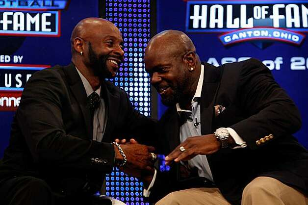 FORT LAUDERDALE, FL - FEBRUARY 06:  (L-R) Jerry Rice and Emmitt Smith talk on stage after they were both announced as two of the newest enshrinees into the Hall of Fame during the Pro Football Hall of Fame Class of 2010 Press Conference held at the Greater Ft. Lauderdale/Broward County Convention Center as part of media week for Super Bowl XLIV on February 6, 2010 in Fort Lauderdale, Florida. Photo: Chris Graythen, Getty Images