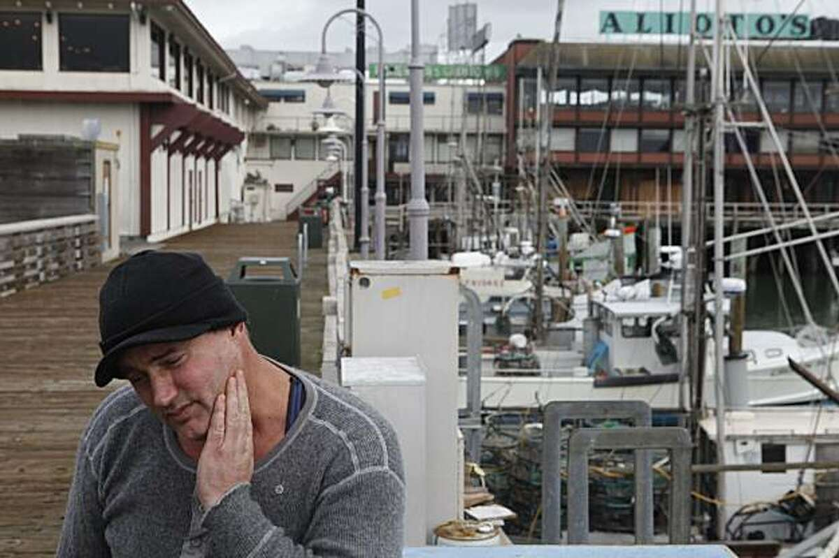 """Salmon fisherman, Sean Cross, 42, stands next to his docked fishing boat at Fishermans Wharf on Monday Feb. 08, 2010 in San Francisco, Calif. where dozens of salmon boats and the fisherman who operate them have been sitting still for two years because they are now allowed to fish. """"We're doomed. Without salmon we just can't make it,"""" said Cross"""