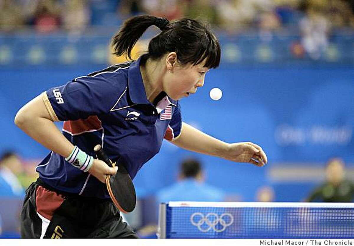 USA table tennis player, Chen Wang, serves against her opponet Cecelia Otu Offiong, of Nigera, who she went on the defeat and help the US team to advance to the next round, on Thursday Aug. 14, 2008, at the 2008 Olympics in Beijing, China.