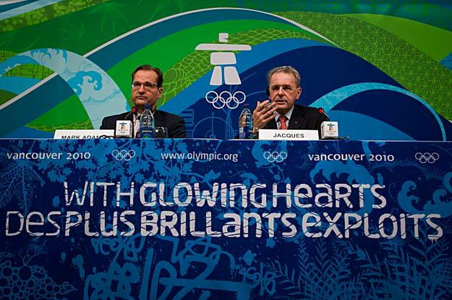 International Olympic Committee President Jaques Rogge, right, and  IOC spokesman Mark Adams, left, address the media during a news conference at the Main Media Center  in advance of the 2010 Winter Olympics on Monday, Feb. 8, 2010, in Vancouver. ( Smiley N. Pool / Houston Chronicle ) Photo: Smiley N. Pool, Houston Chronicle