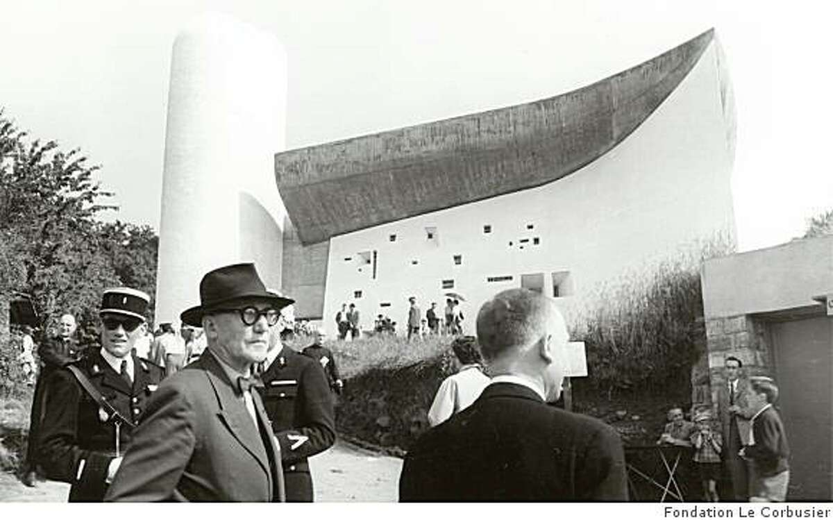 Architect Le Corbusier (front left) in front of the building that many consider his final masterwork, Notre-Dame-du-Haut in Ronchamp, France at its opening in 1955. From the new Phaidon book