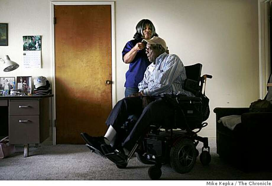 Just as she does seven days a week, Pauline Beck, 62, a home health care worker, takes care of her 87-year-old disabled client, John Thornton on Thursday August 14, 2008 in Oakland Calif. A year ago Barak Obama spent the day with Beck to better understand the importance of a home health care worker. Photo: Mike Kepka, The Chronicle