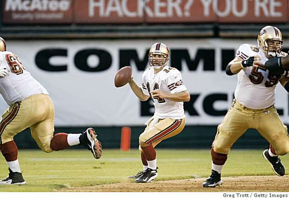 OAKLAND, CA - AUGUST 08:  Quarterback J.T. O'Sullivan #14 of the San Francisco 49ers drops back to pass against the Oakland Raiders on August 8, 2008 at McAfee Coliseum in Oakland, California.  (Photo by Greg Trott/Getty Images) Photo: Getty Images