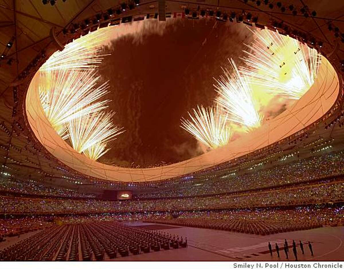 Fireworks explode over the National Stadium during opening ceremonies for the 2008 Summer Olympic Games.