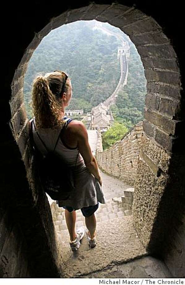 Diver, Laura Wilkinson, who is competing in her last Olympic Games, was a gold medalist at the 2000 Sydney Olympic games, looks out over the  Great Wall of China,  Mutainyu, North of Beijing. The entire US diving team took an excursion to the wall to check things out just two days before opening ceremonies of the 2008 Olympics Games in Beijing, China. Photo: Michael Macor, The Chronicle