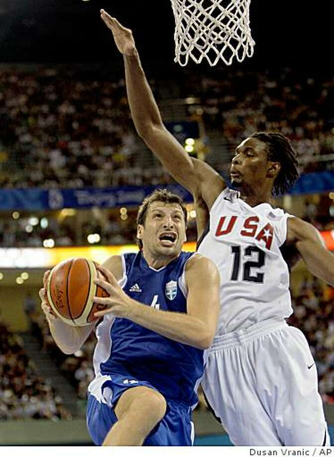 USA's Chris Bosh, right,  guards Greece's Theodoros Papaloukas during during the men's basketball competition at the Beijing 2008 Olympics in Beijing, Thursday, Aug. 14, 2008. (AP Photo/Dusan Vranic) Photo: Dusan Vranic, AP