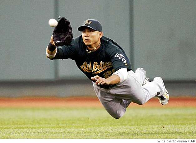 Oakland Athletics center fielder Carlos Gonzalez makes a diving catch on a ball hit by Boston Red Sox's Jason Varitek during the first inning. (Winslow Townson / AP) Photo: Winslow Townson, AP