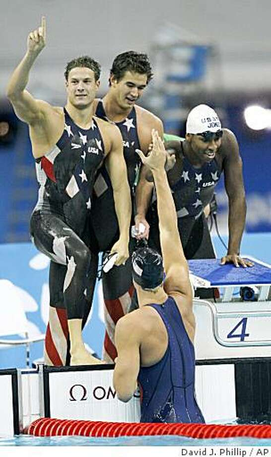U.S. swimmers, Ben Wildman-Tobriner, Nathan Adrian and Cullen Jones, from left, celebrate with teammate Matt Grevers, bottom, after breaking a world record as they won a men's 4x100-meter freestyle relay heat during the swimming competitions in the National Aquatics Center at the Beijing 2008 Olympics in Beijing, Sunday, Aug. 10, 2008. (AP Photo/David J. Phillip) Photo: David J. Phillip, AP