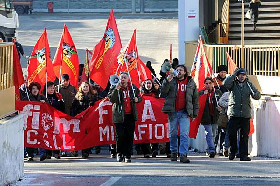 Demonstrators shout slogans during a labour strike at the Fiat Mirafiori assembly plant in Turin, northern Italy, Wednesday, Feb. 3,2010. Fiat workers across Italy are going on strike to protest plans to end auto production at a Sicilian plant next year.Wednesday's four-hour strike, marked the first nationwide work stoppage since CEO Sergio Marchionne took over the company in 2004 and mounted its turnaround. Photo: Massimo Pinca, AP