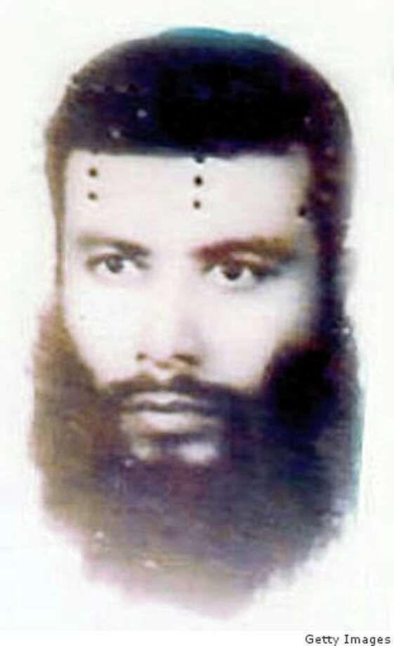 This undated handout photo courtesy of the US National Counterterrorism Center in Washington, DC, shows Midhat Mursi al-Sayid Umar. Al-Qaeda announced the ?martyrdom? of Abu Khabab al-Masri, an explosives and poisons expert, and the ?martyrdom? of three other individuals and children in a communiqu� issued on jihadist forums on August 2, 2008.  The message is dated July 30, and is signed by Mustafa Abu al-Yazid (AKA Sheikh Saeed), the general head of al-Qaeda in Afghanistan.  Abu Khabab (AKA Midhat Mursi al-Sayid Umar) operated a training camp in Derunta, Afghanistan, and distributed training manuals that contain instruction for making chemical and biological weapons.  According to reports, Abu Khabab and five other individuals were killed in a missile strike in South Waziristan on July 28.  The communiqu� does not indicate the date, location, or how Abu Khabab and the others ? Sheikh al-Murabbi Muhammad Ibrahim bin Abu al-Faraj al-Masri, Abdul Wahhab al-Masri, Abu Islam al-Masri, and some children ? were killed.   AFP PHOTO / US NATIONAL COUNTERTERRORISM CENTER /  == RESTRICTED TO EDITORIAL USE ONLY / GETTY OUT == (Photo credit should read HO/AFP/Getty Images) Photo: HO, Getty Images