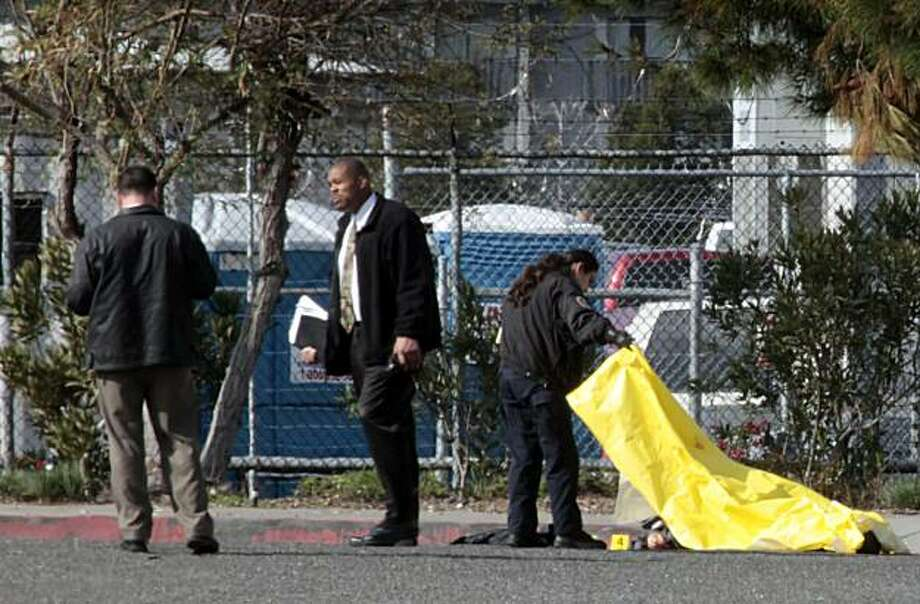 Hayward police inspect one of two bodies found Tuesday morning at Bay Cities Auto Auction in Hayward. Photo: Lance Iversen, The Chronicle