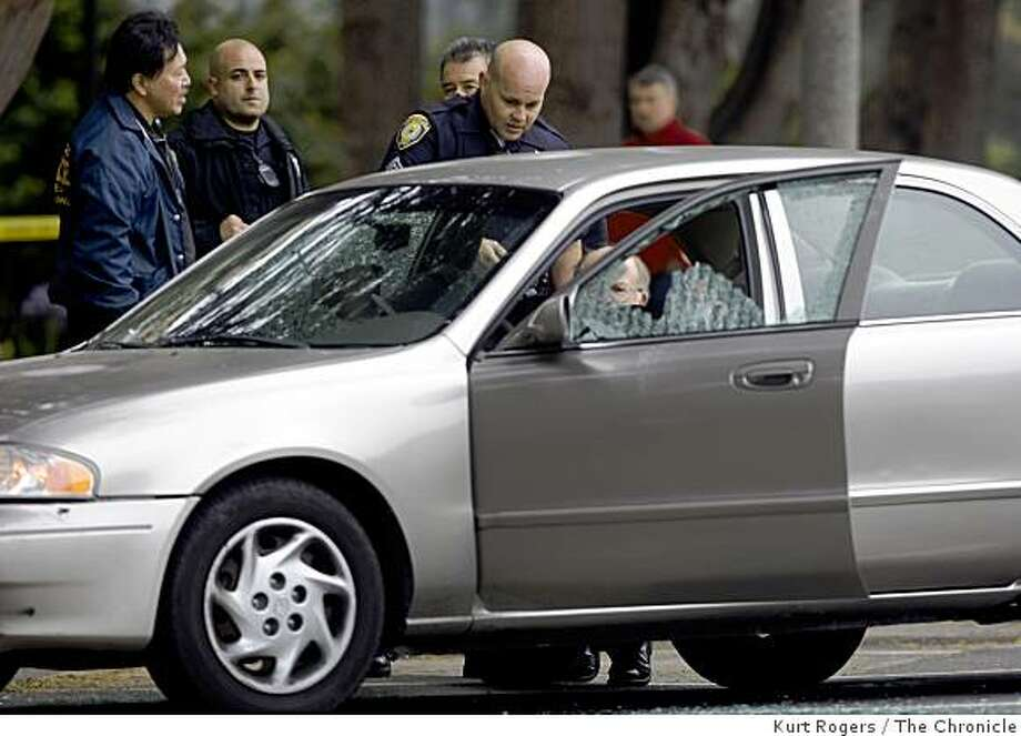 San Francisco Police investigate 2 men shot to death in a car on Golden Gate Ave next to the USF campus. on Thursday  , Aug 14  2008 in San Francisco , Calif Photo: Kurt Rogers, The Chronicle