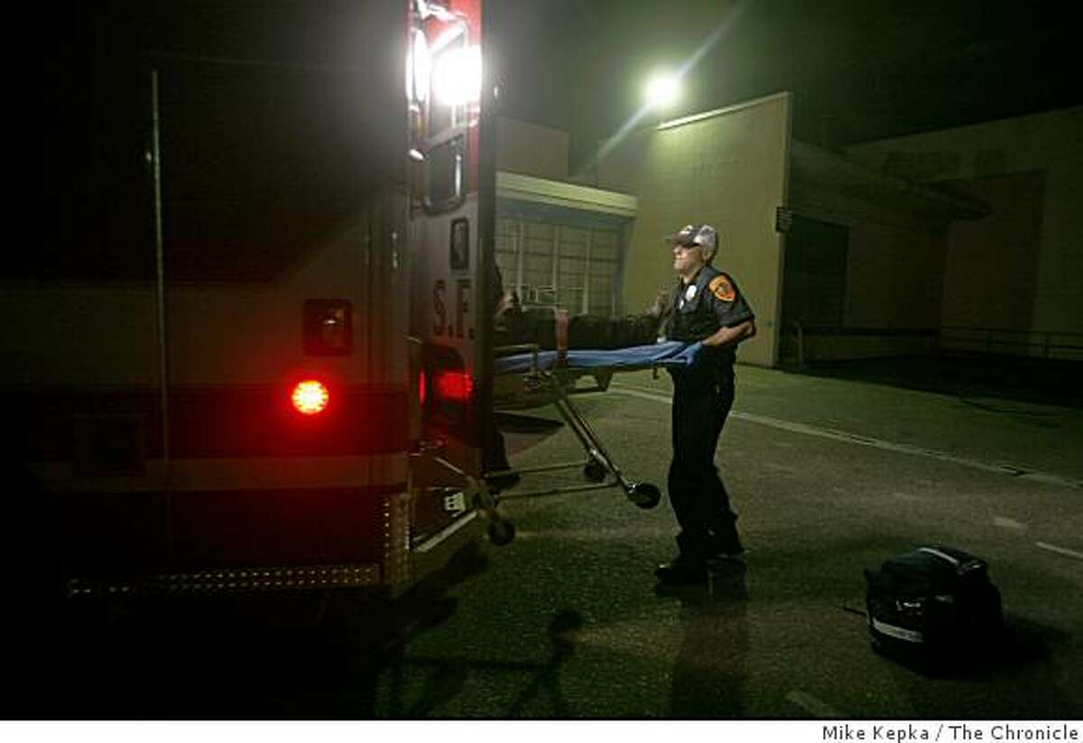 In this file photo, a dynamically deployed emergency responder with the San Francisco Fire Department lifts a patient into the back of an ambulance in San Francisco.