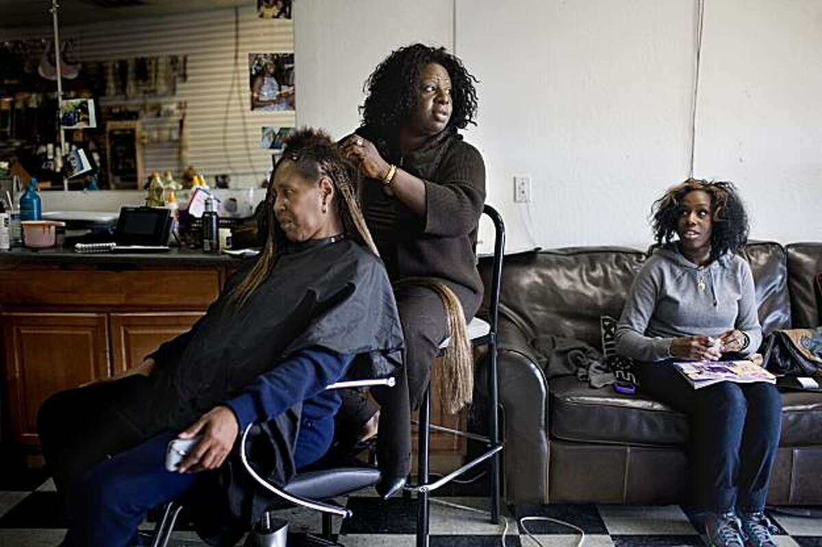 """Doris Campbell, 45, braids the hair of Annie Davis, 56, with her daughter, Hawa Fallay, 23 at right, in her beauty shop, My African Heritage, in the """"infamous Crest,"""" short for Hillcrest, a neighborhood in North Vallejo that was known for national rap artists Mac Dre and Mac Mall, in Vallejo, Ca., on Wednesday, Feb. 10, 2010. """"Idle minds is the devil's playground,"""" says Campbell, of today's youth not having enough resources to turn to and away from crime and drugs."""