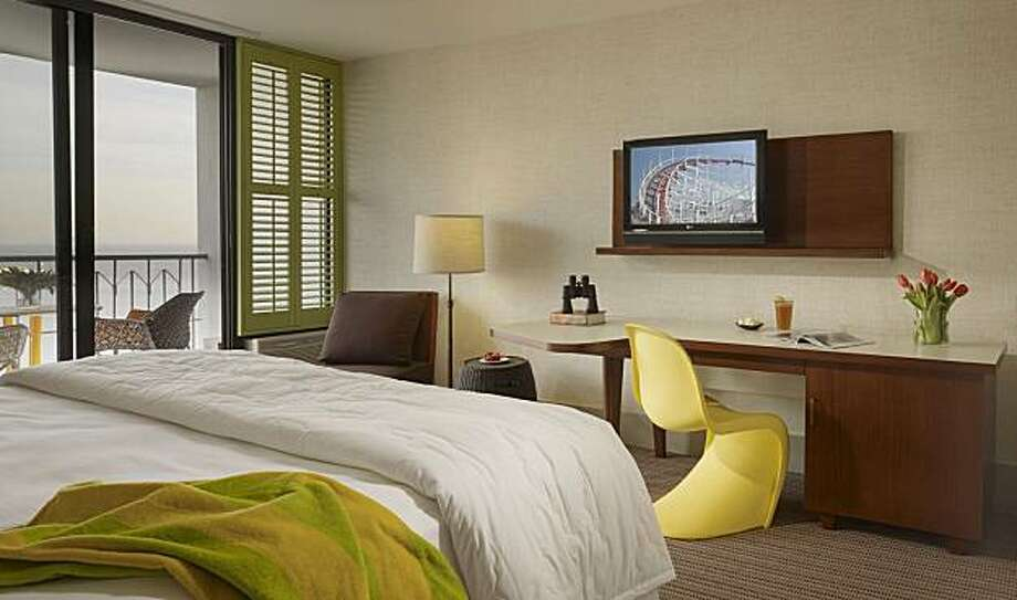 For better viewing from the bed, flat-screen televisions should be installed higher on the wall. Photo: Courtesy Of Santa Cruz Dream Inn