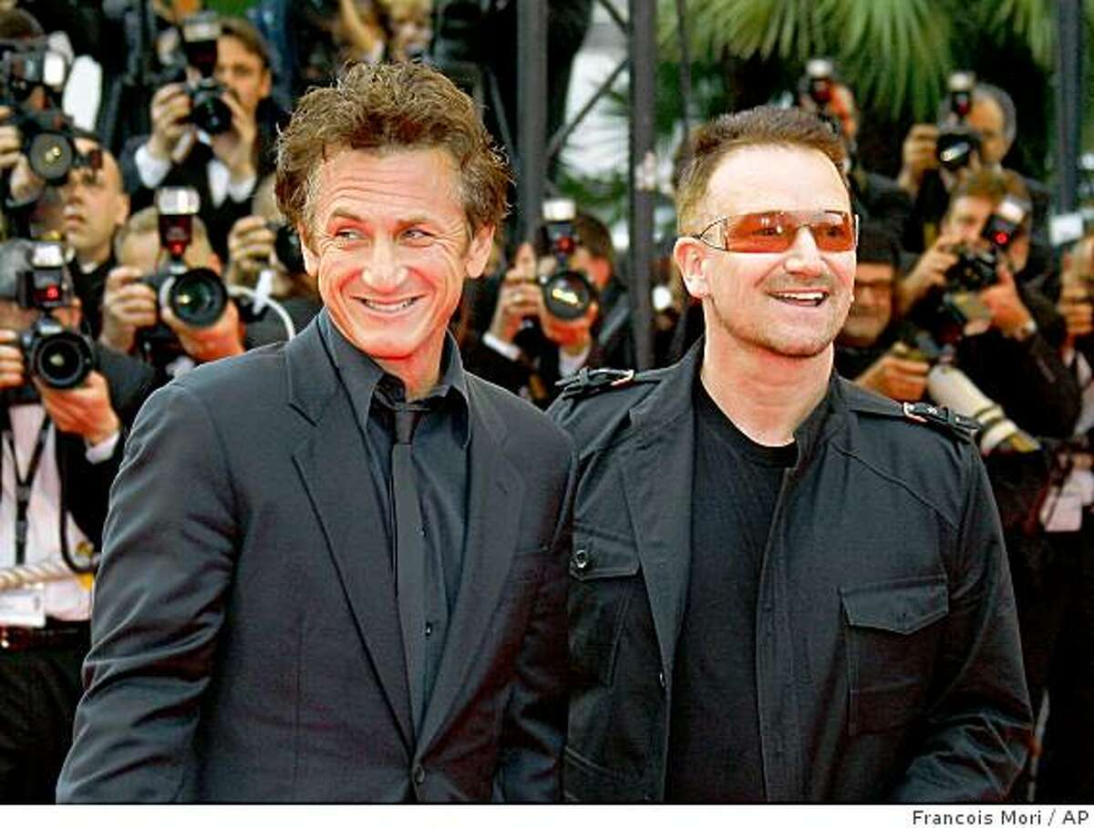 """Irish musician Bono, right, and American actor, director and Cannes jury president Sean Penn arrive for the premiere of the film """"The Third Wave"""" during the 61st International film festival in Cannes, southern France, Friday, May 16, 2008. (AP Photo/Francois Mori)"""