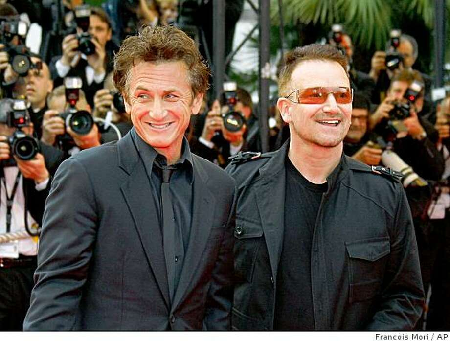 "Irish musician Bono, right, and American actor, director and Cannes jury president Sean Penn arrive for the premiere of the film ""The Third Wave"" during the 61st International film festival in Cannes, southern France, Friday, May 16, 2008.  (AP Photo/Francois Mori) Photo: Francois Mori, AP"