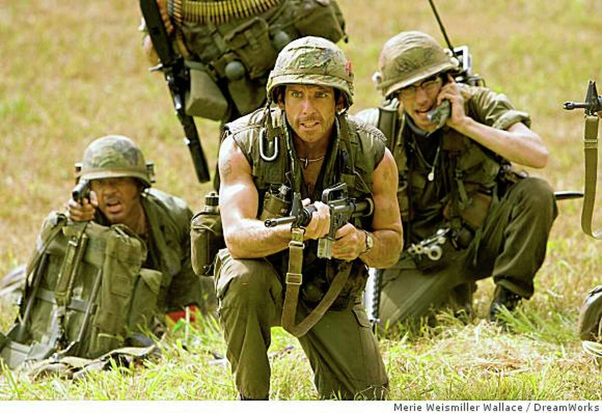 (Left to right) Kirk Lazarus (Robert Downey Jr.), Tugg Speedman (Ben Stiller), and Kevin Sandusky (Jay Baruchel) are actors shooting a war movie who get caught up in a real battle in the action comedy ?Tropic Thunder.?