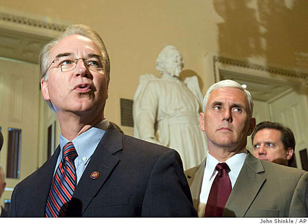 Rep. Tom Price, R-Ga., left, accompanied by Rep. Mike Pence, R-Ind., and others, makes remarks during a news conference on Capitol Hill in Washington, Monday, Aug. 4, 2008, demanding that House Speaker Nancy Pelosi bring back Congress and has a vote on energy legislation during the summer recess. (AP Photo/Politico.com. John Shinkle)