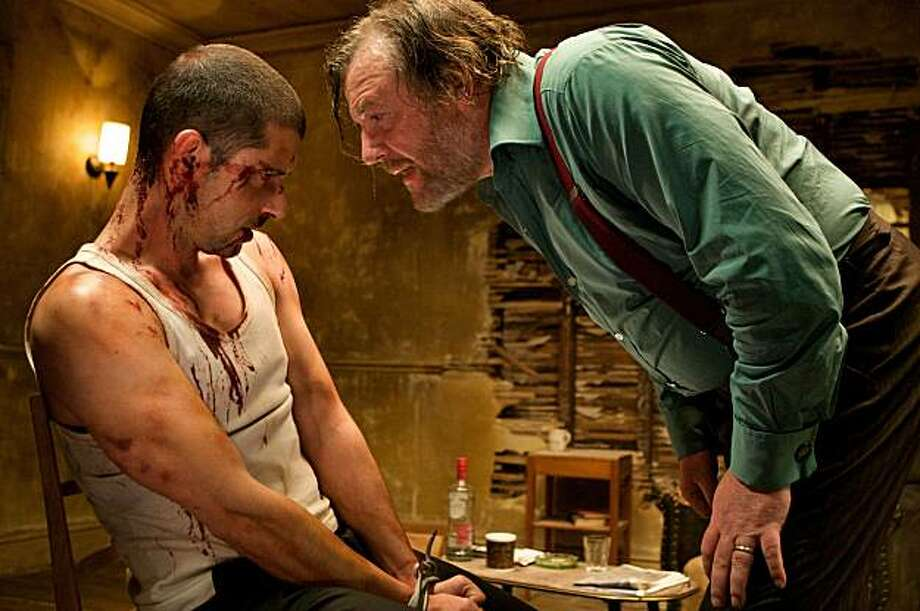 "Ray Winstone as ""Colin Diamond"" confronts Melvil Poupad as ""Loverboy"" in a scene from ""44 Inch Chest."" Photo: Image Entertainment"