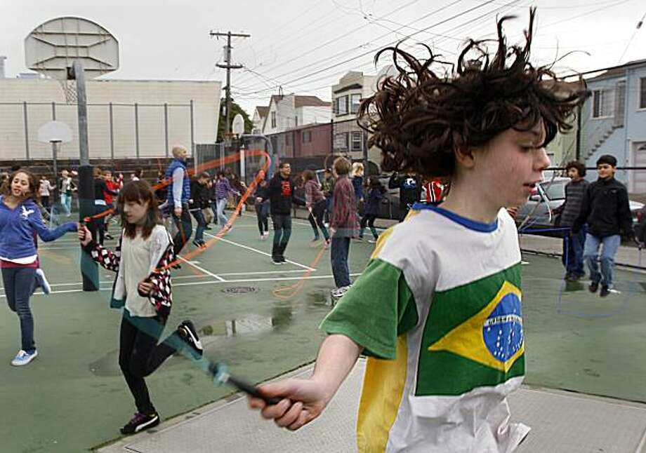 Eytan Schillinger-Hyman, 11, a sixth grader at the San Francisco School, participates in an attempt to break a group jump-roping world record on Monday. Photo: Liz Hafalia, The Chronicle